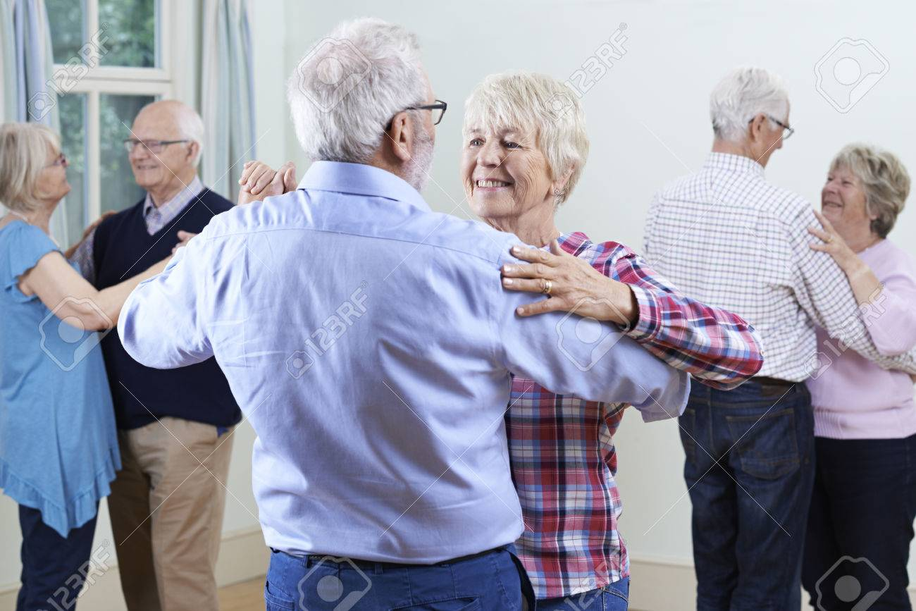 Group Of Seniors Enjoying Dancing Club Together - 63034794