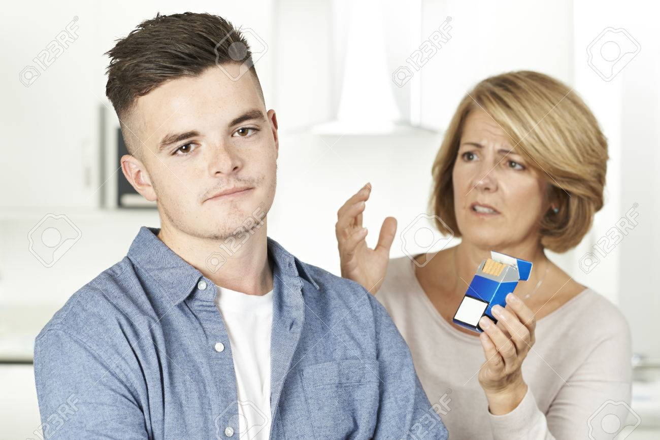 Mother Talking To Teenage Son About Dangers Of Smoking Stock Photo 65627266