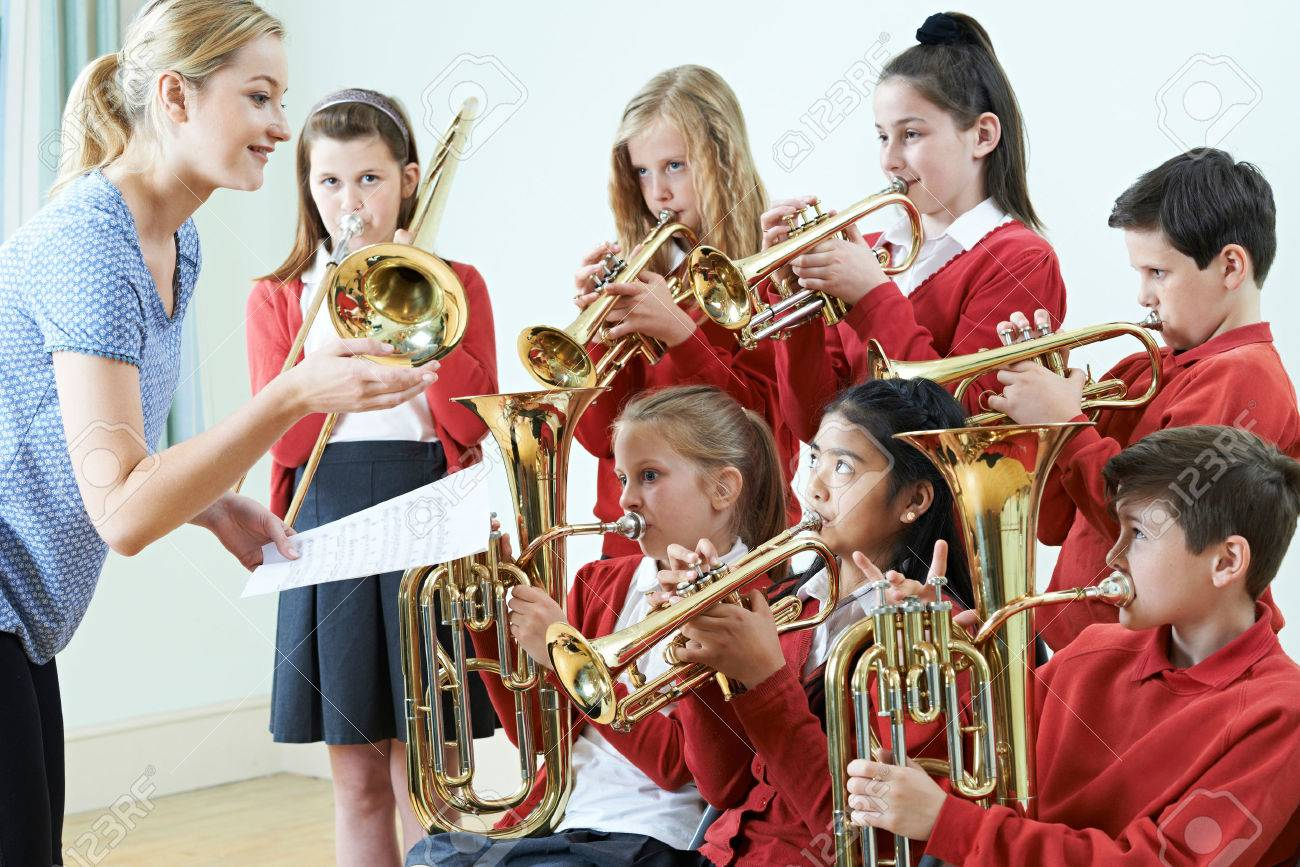 Group Of Students Playing In School Orchestra Together - 68382916