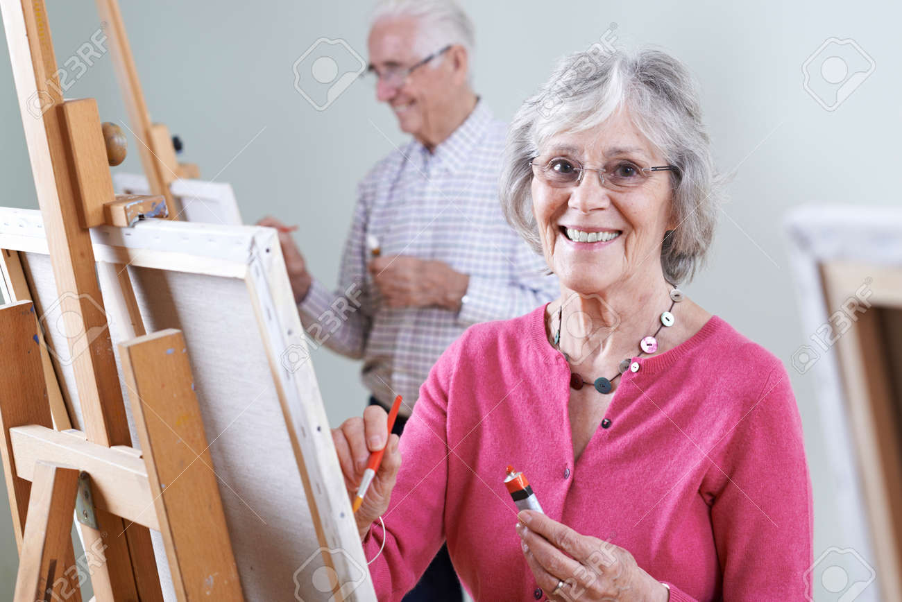 Seniors Attending Painting Class Together - 68449889