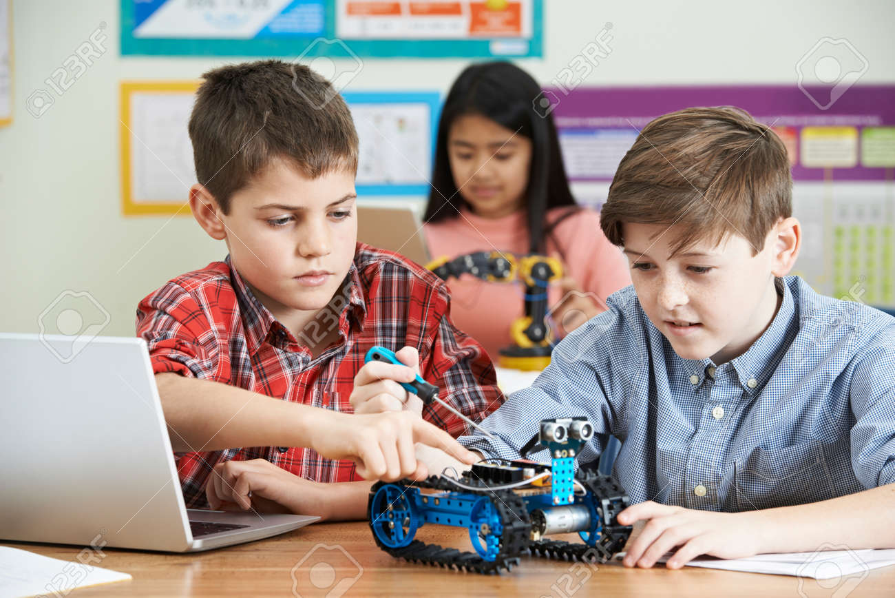 Pupils In Science Lesson Studying Robotics - 68788378
