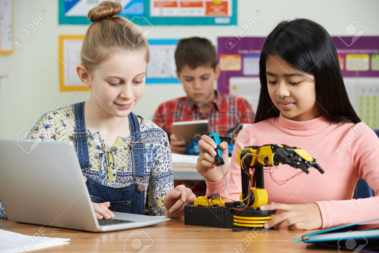 Pupils In Science Lesson Studying Robotics - 69068040