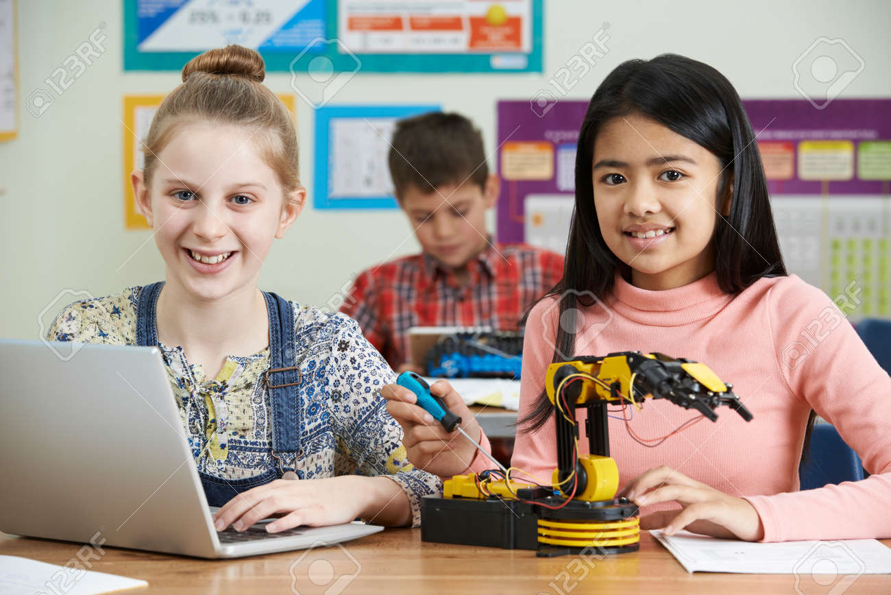Pupils In Science Lesson Studying Robotics - 70616014
