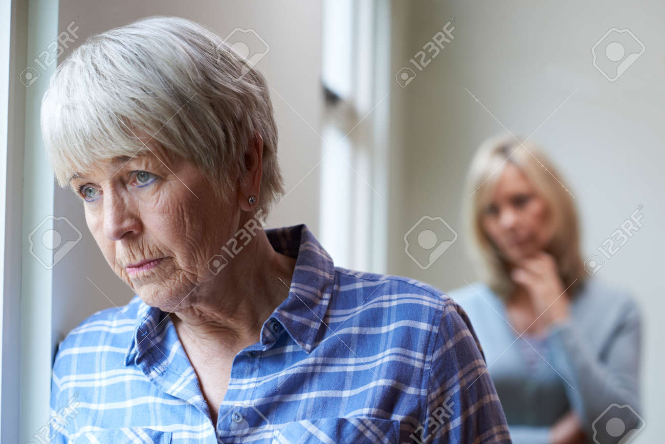 Serious Senior Woman With Adult Daughter At Home - 71627940