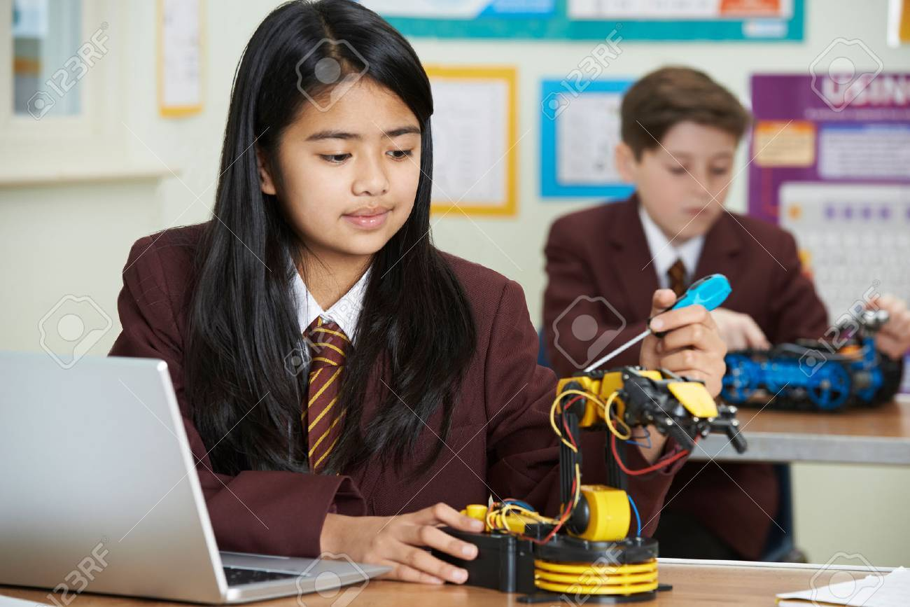 Pupils In Science Lesson Studying Robotics - 71647684