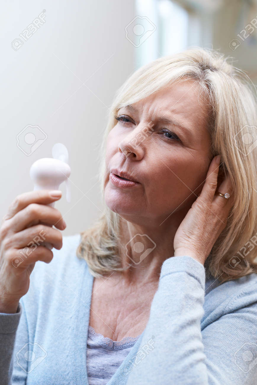 Mature Woman Experiencing Hot Flush From Menopause - 74422864