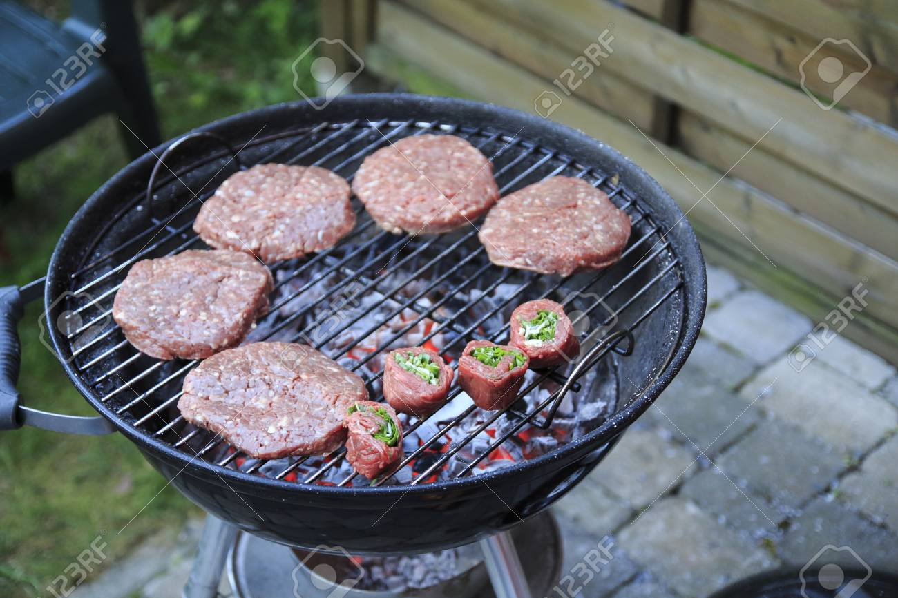 Paddies Burgers Sausages And Meat Rolls On Charcoal Grill Stock Photo Picture And Royalty Free Image Image 113538054