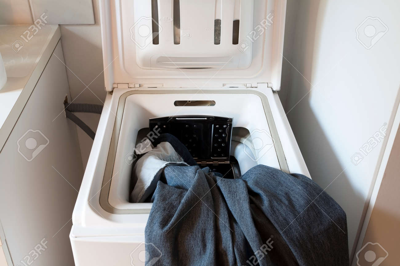 Laundry machine with open hatch and jeans - 50104951