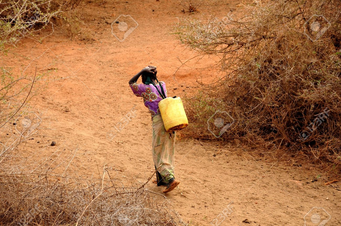 African woman carrying water cans - 15255415