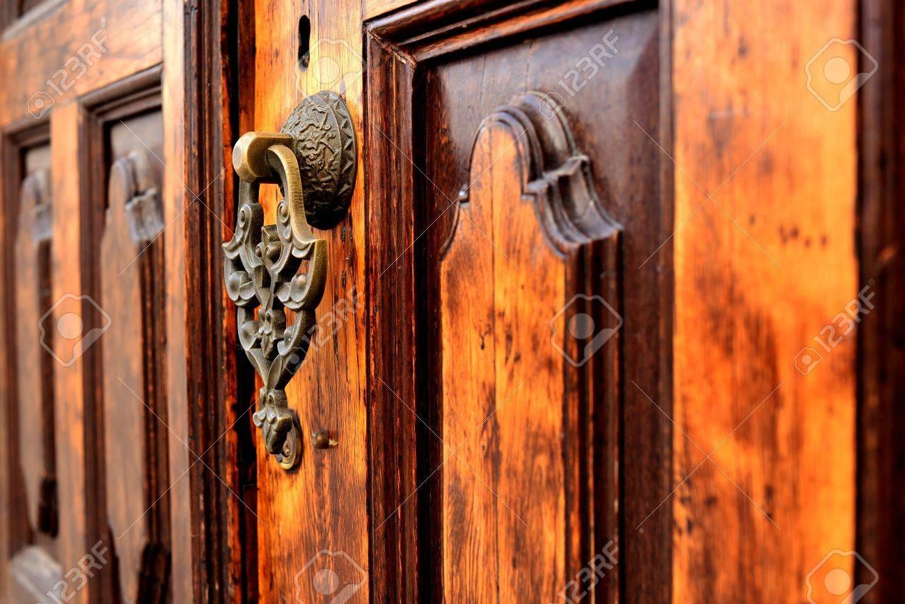 wooden old door and antique door knocker Stock Photo - 17092493