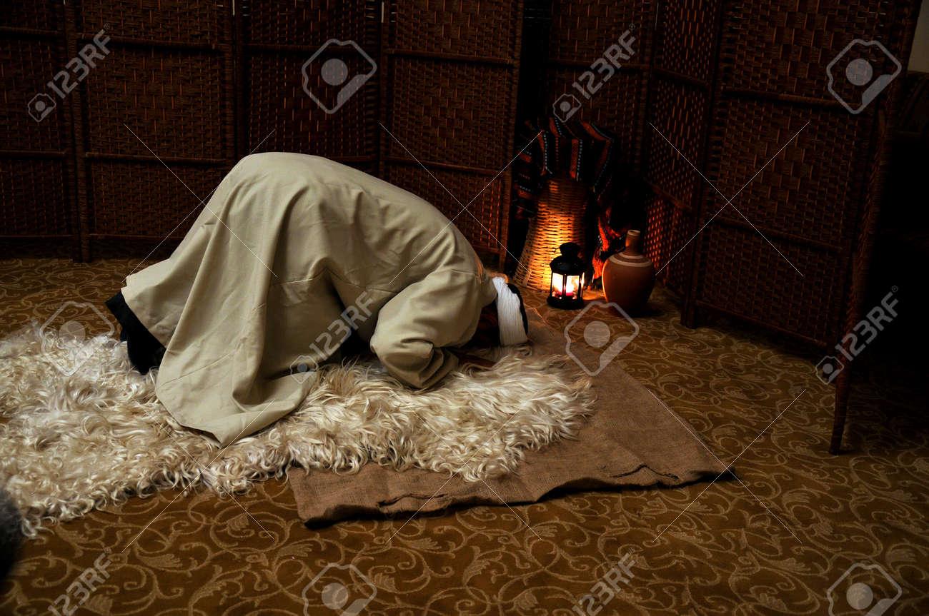 Muslim man praying alone, in prostration