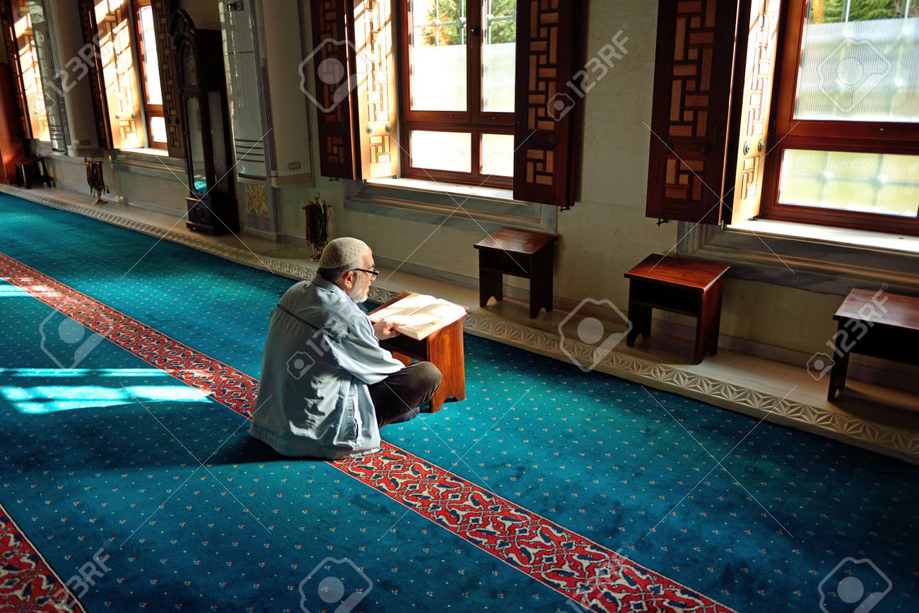 ISTANBUL, TURKEY - 19 JANUARY  Unknown man in the Tunahan Mosque a read Quran in Istanbul, Turkey on january 19, 2014  Tunahan mosque was made in 2004  Stock Photo - 25220073