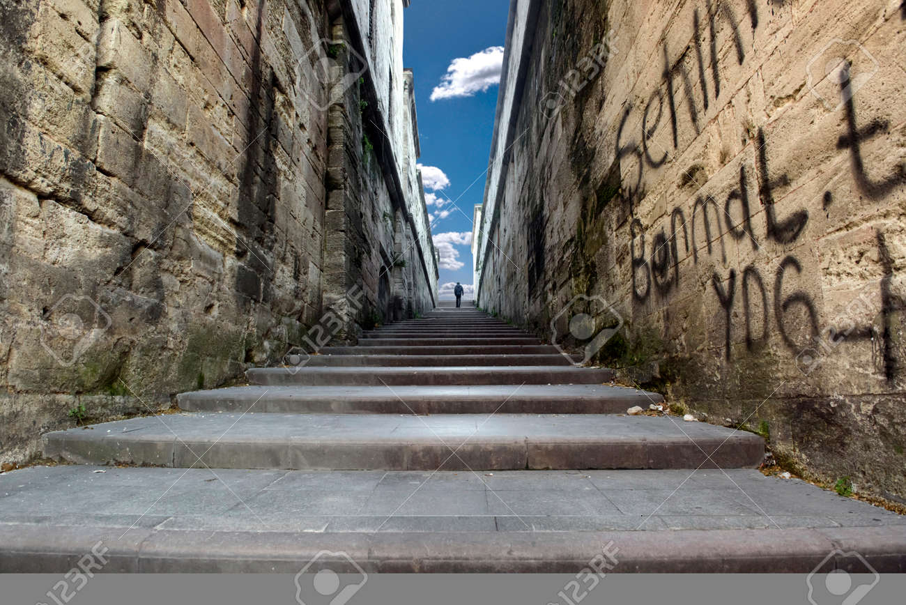 People Walking On The Stairs Between Two Walls Stock Photo Picture