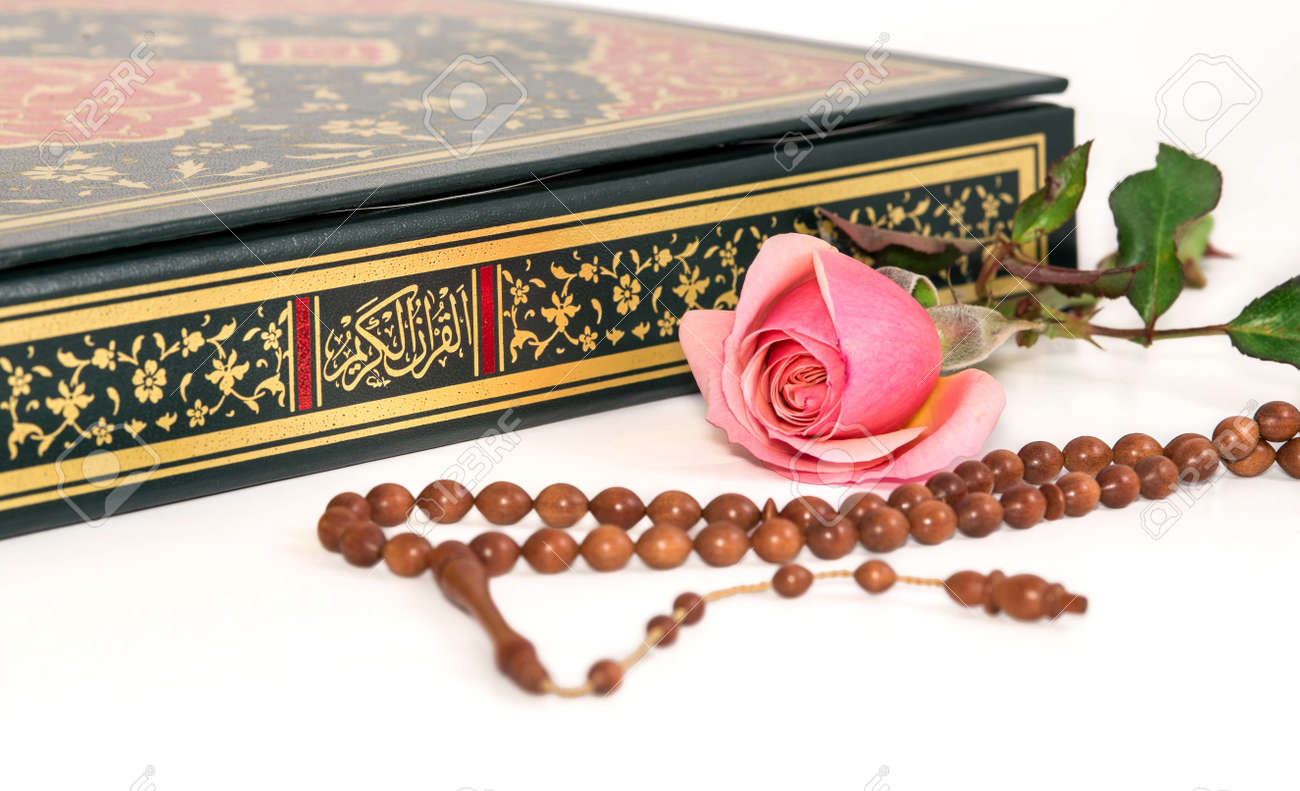 Muslim Rosary Beads And Rose On The Holy Quran Stock Photo Picture