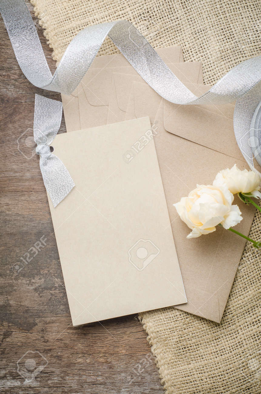 Blank Invitation Card With Brown Envelope And Rose Flowers On ...
