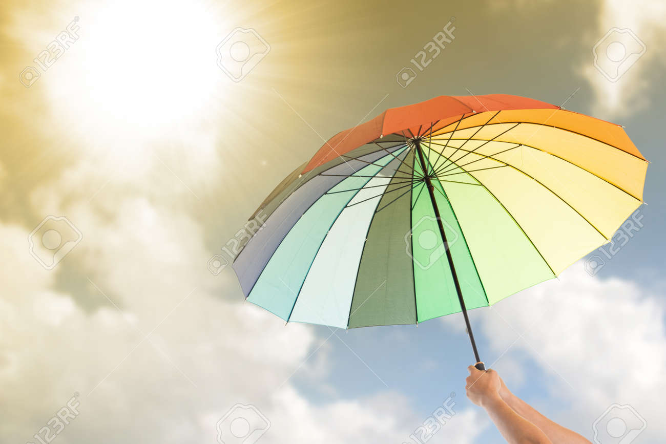 Holding Colorful Umbrella For Protection UV Light. Stock Photo ... for Colorful Umbrella Photography  70ref