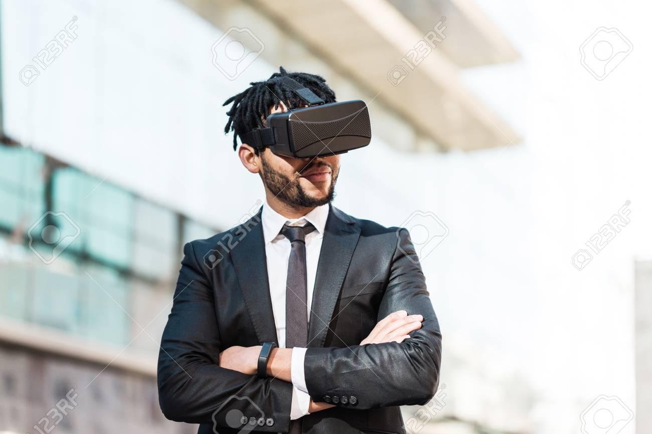 bc24effd64b Afro Businessman Playing Virtual Reality Simulation