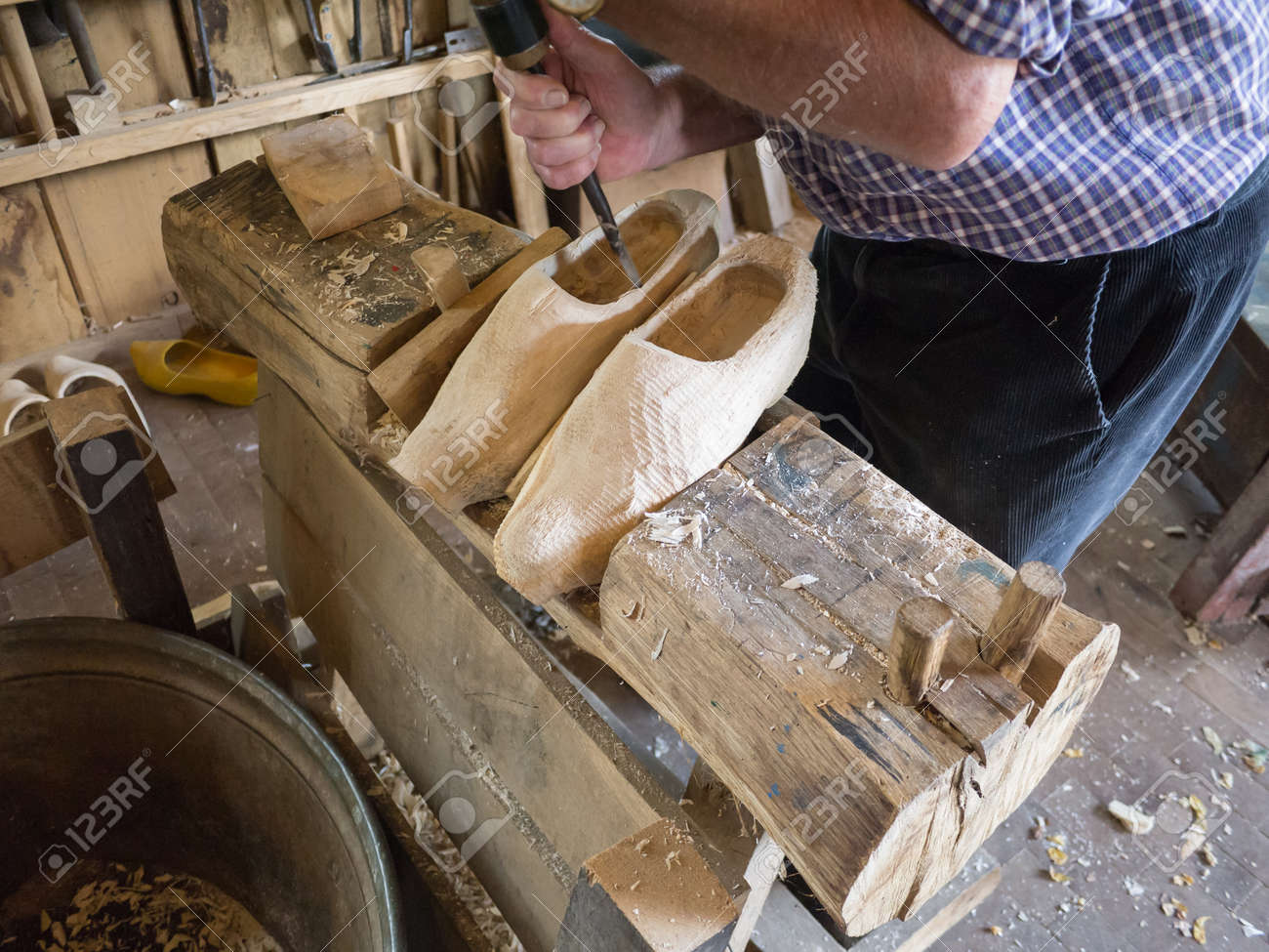 carving of the inside of a pair of wooden shoes by hand stock