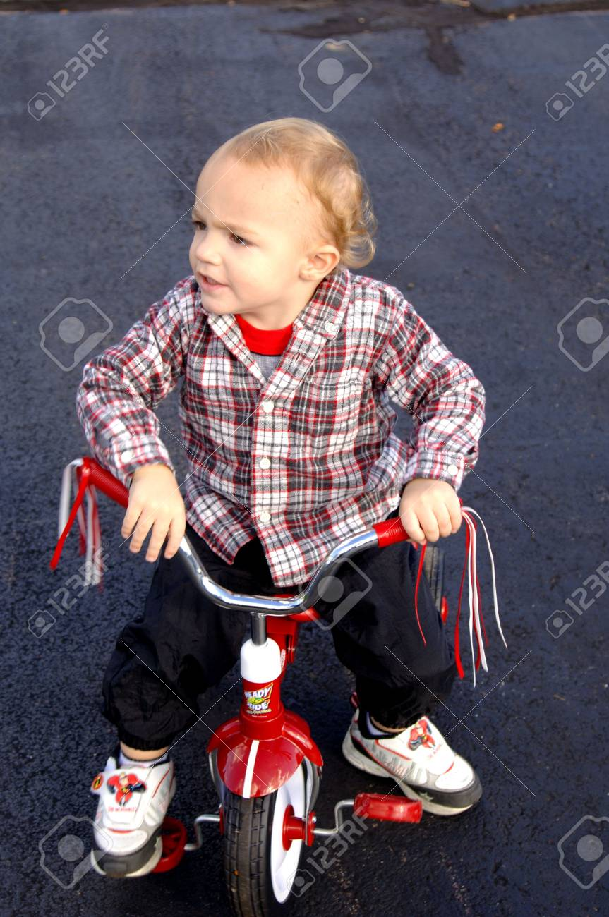 Toddler sitting on tricycle Stock Photo - 302390