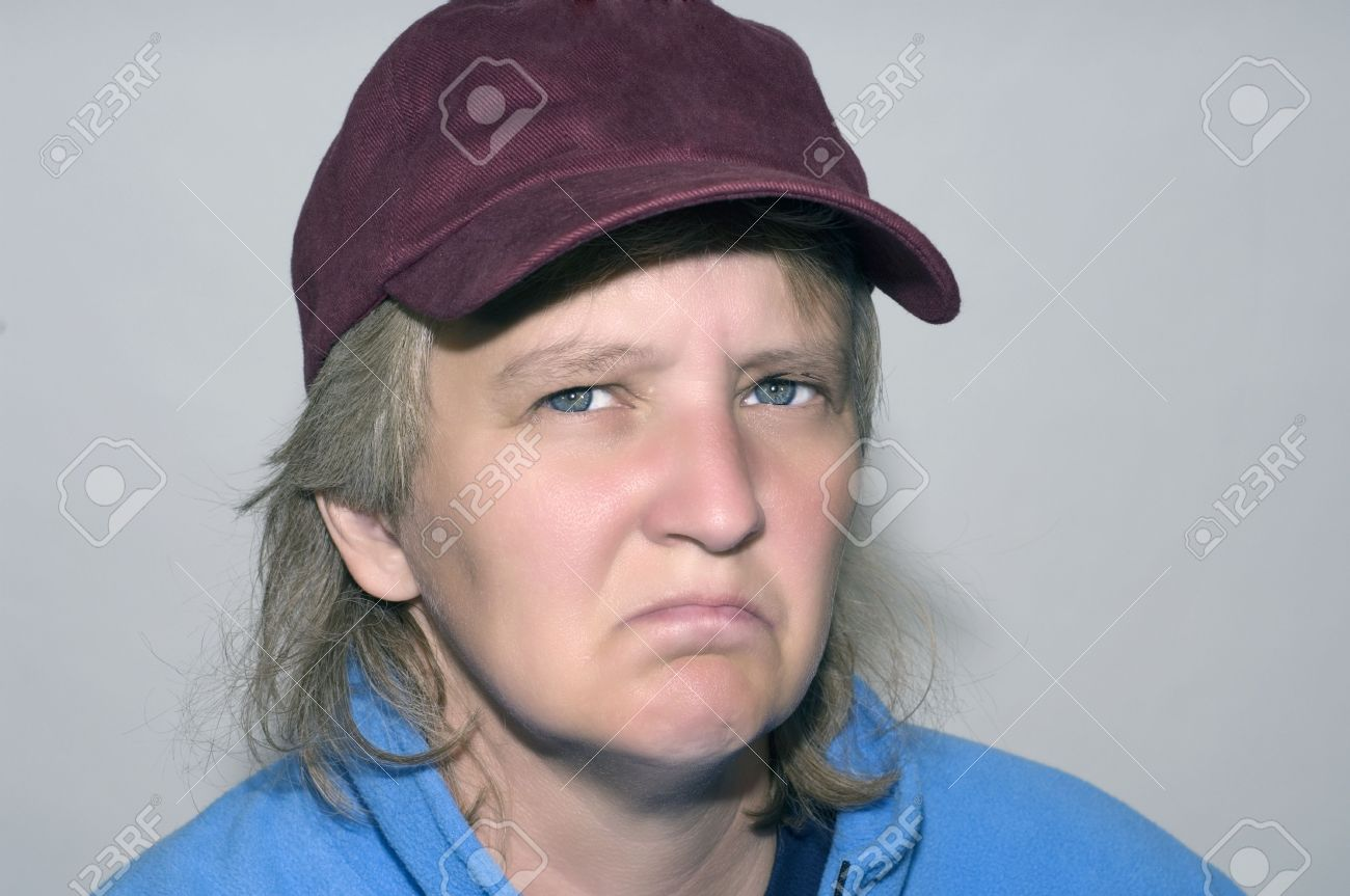Old woman wearing baseball hat looking grumpy and miserable Stock Photo -  3760726 06f1e36829e