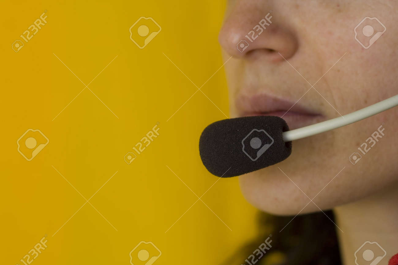 A closeup of the headseat and mouth of a call operator Stock Photo - 970693