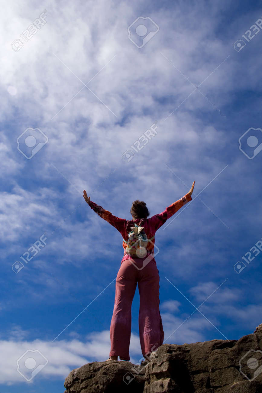 a young woman feeling the breeze Stock Photo - 1577129