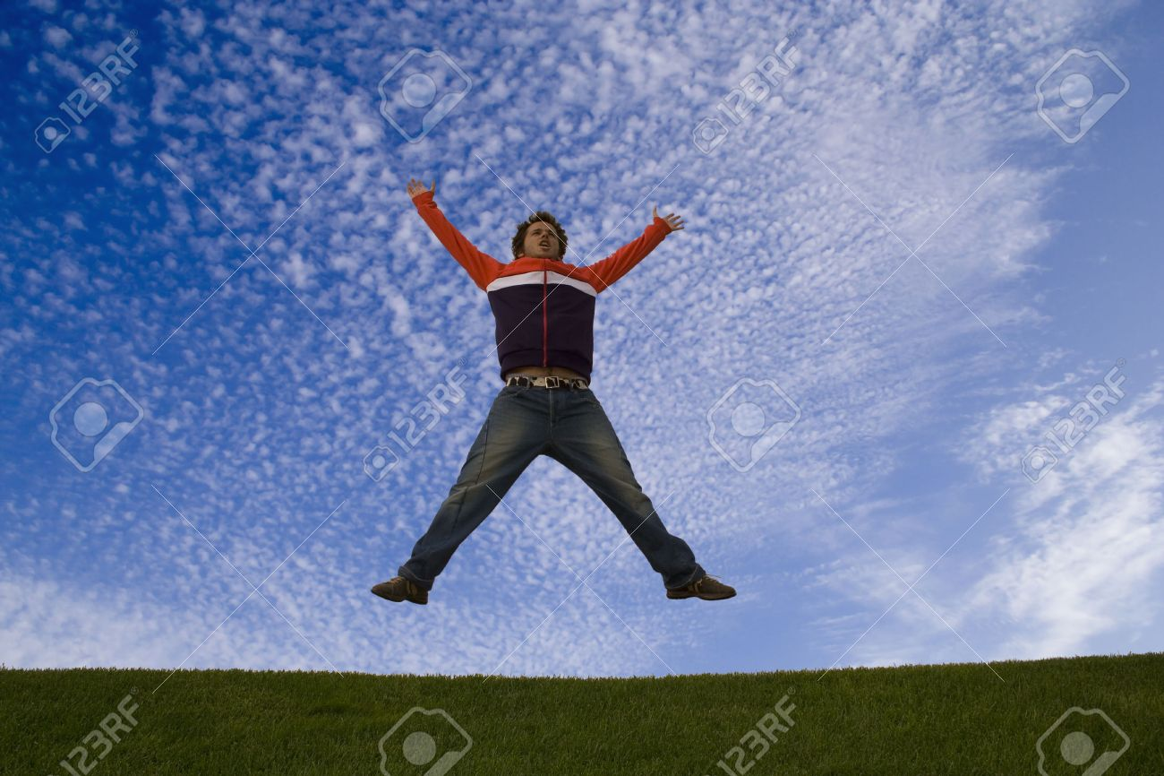 young man feeling very happy, jumping at the park Stock Photo - 2223491