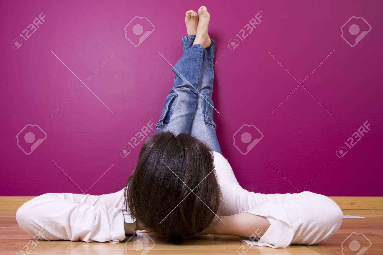 woman relaxing, looking a t her new painted wall (focus on the head) Stock Photo - 3069869