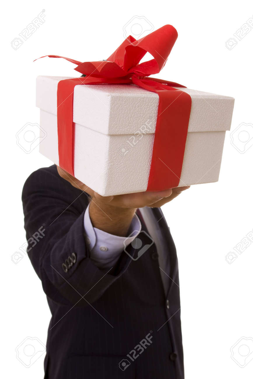 a businessman offering a gift to you (selective focus) Stock Photo - 3669459