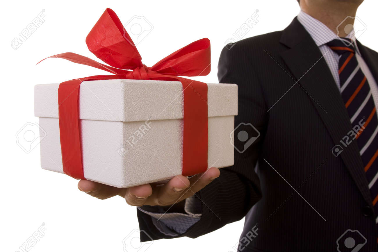 a businessman offering a gift to you (selective focus) Stock Photo - 3810448