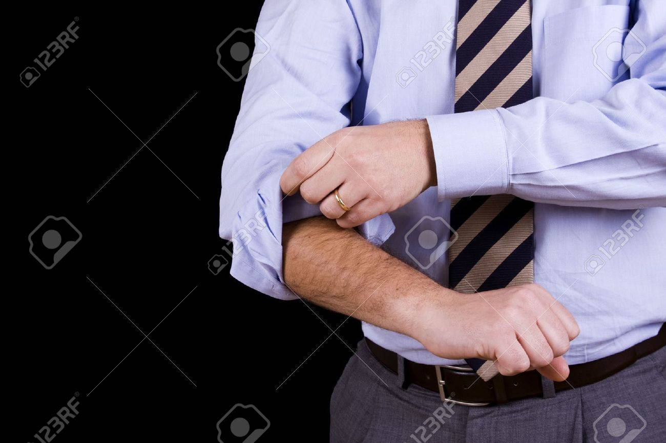 businessman rolling his sleeves ready to work (isolated on black) Stock Photo - 4202060