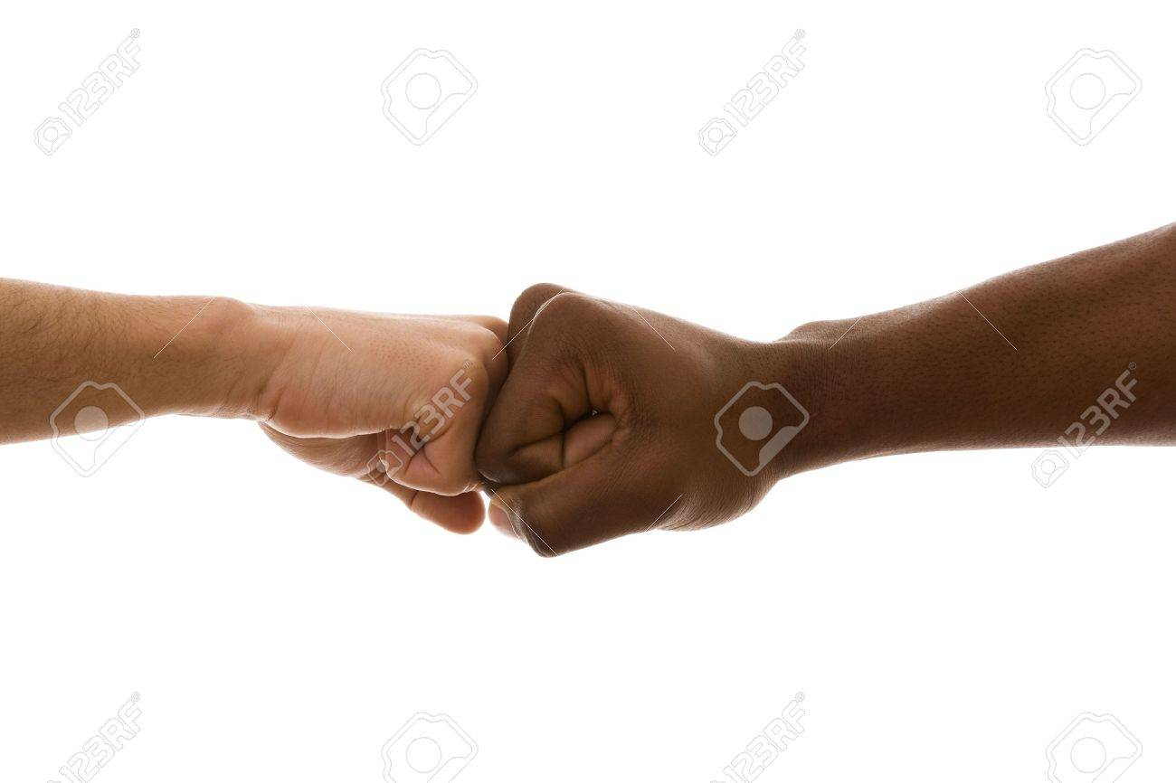 multiracial fist to fist agreement (isolated on white) Stock Photo - 4500063