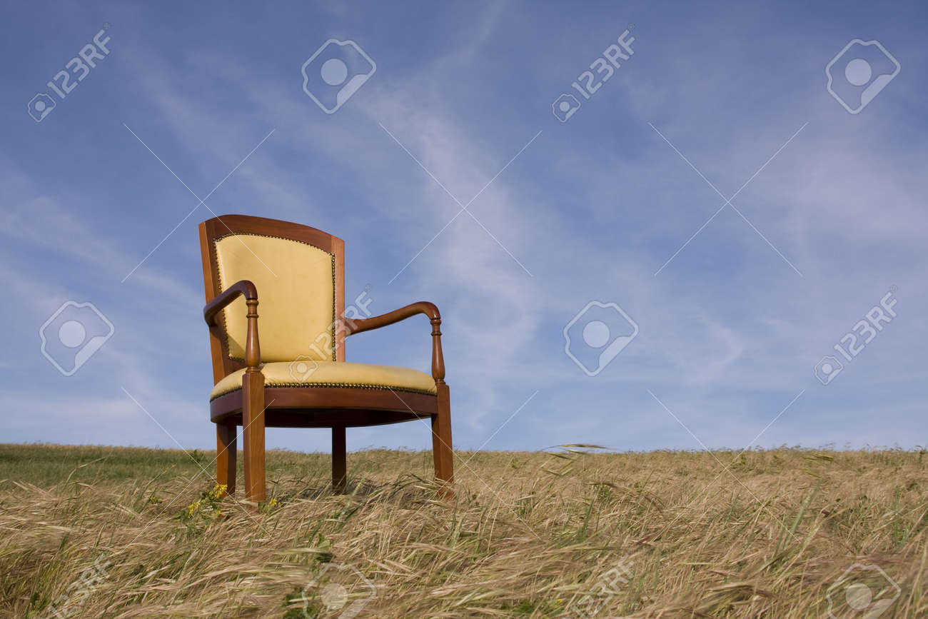 Empty Chair Outside At The Grass Field Stock Photo   4666428