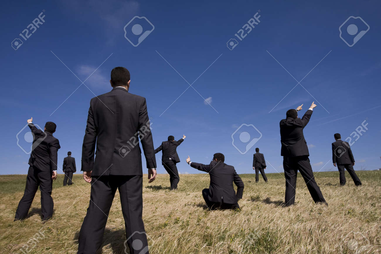 a group of businessman at the field searching for something Stock Photo - 4706651