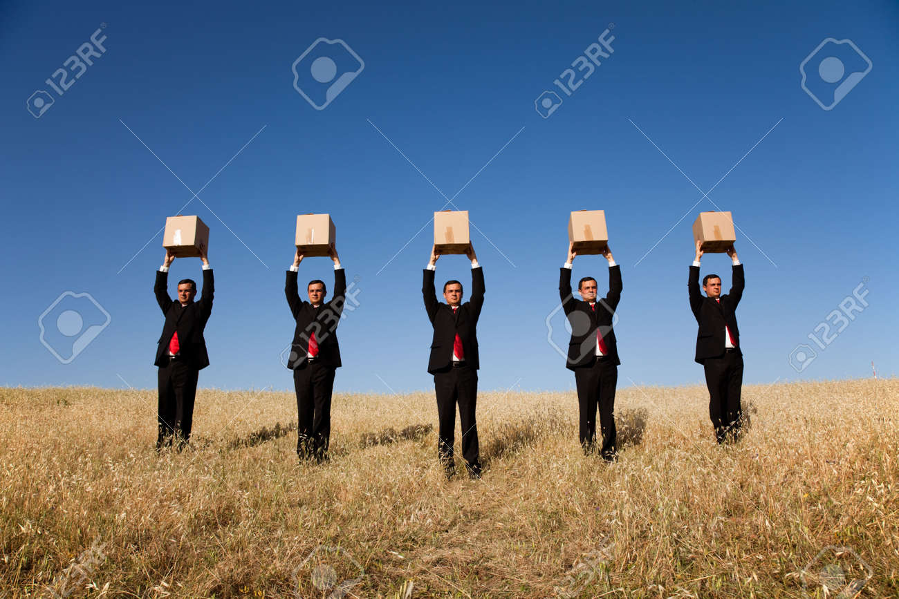 five businessman lineup holding a cardboard box over his head Stock Photo - 5521281