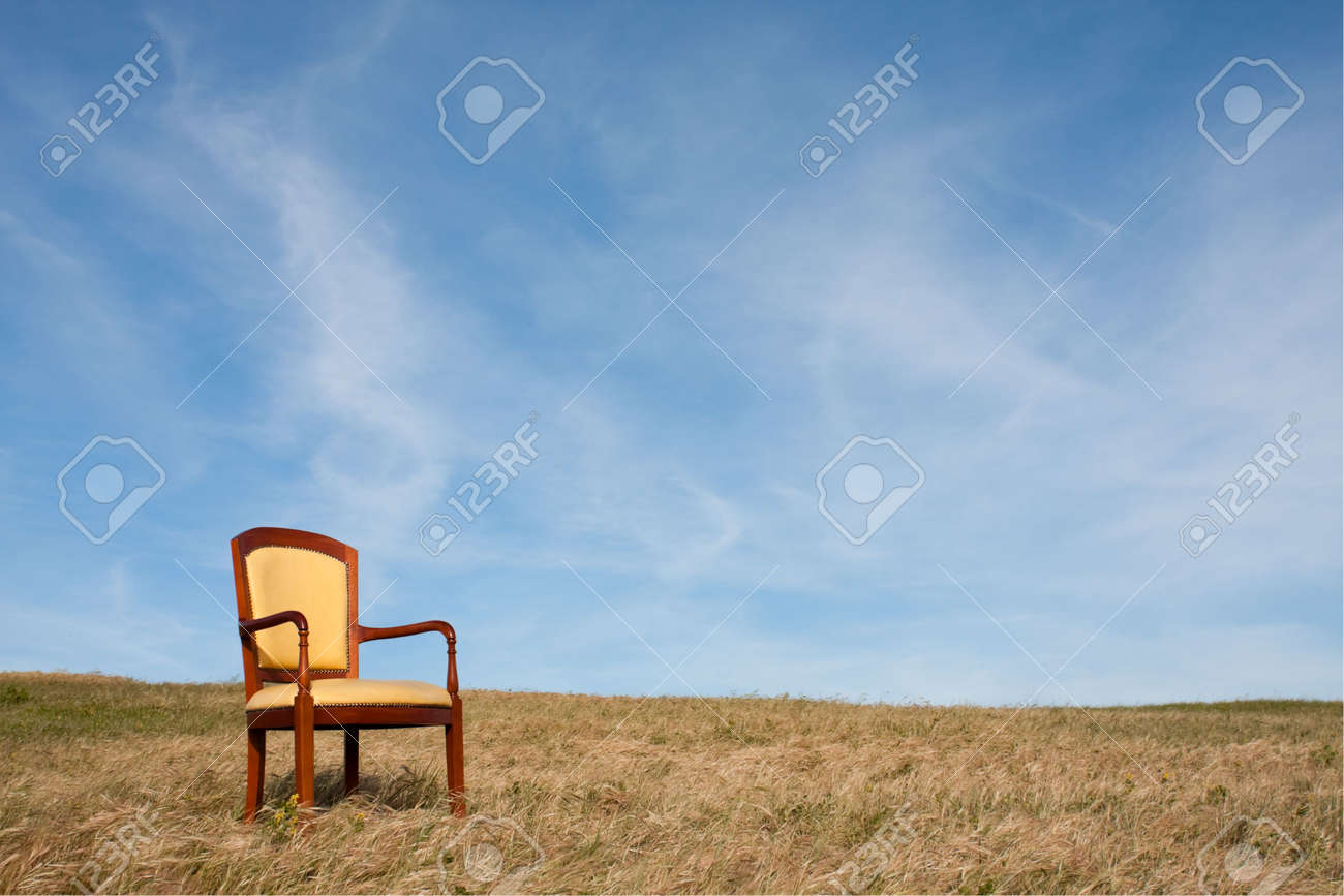 Empty Chair Outside At The Grass Field Stock Photo   5826993