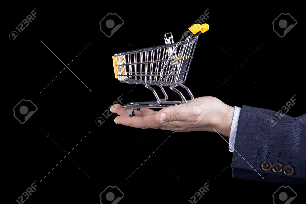 hand holding a shopping cart (selective focus) Stock Photo - 6953583