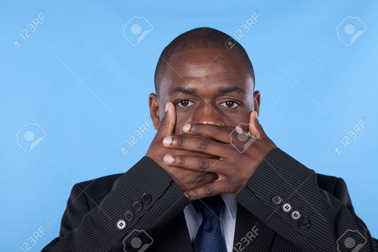 african businessman with hands covering his mouth Stock Photo - 7812207