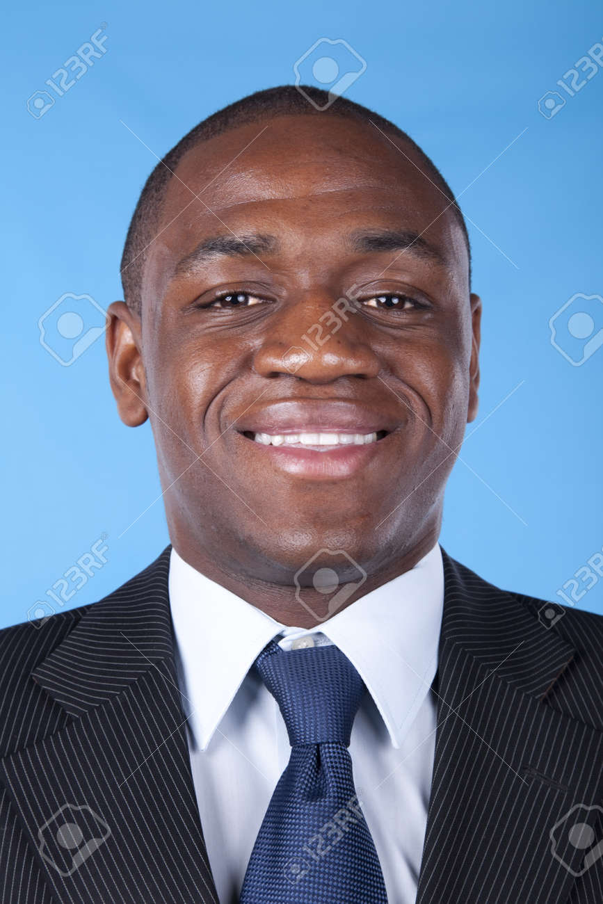 African businessman smiling with a blue background Stock Photo - 7812220