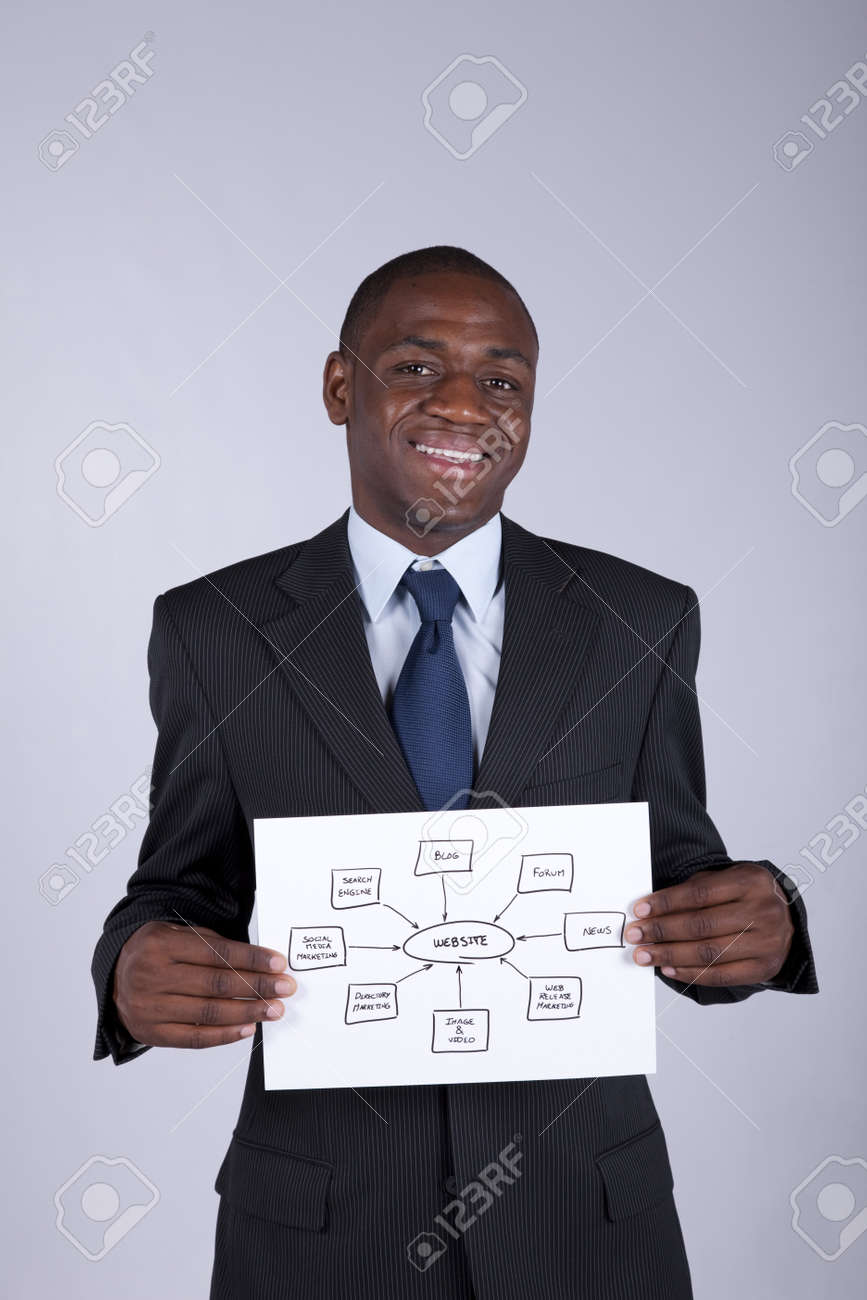 african businessman holding a website shema solution Stock Photo - 7812103