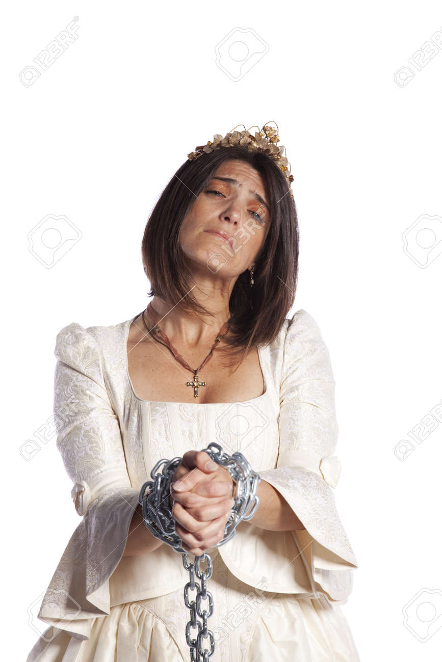 sad bride trapped into marriage with chains (isolated on white) Stock Photo - 8172267