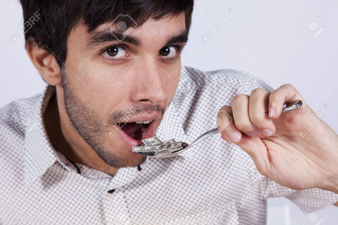 Man eating money at a plate with a fork and a knife Stock Photo - 8174818
