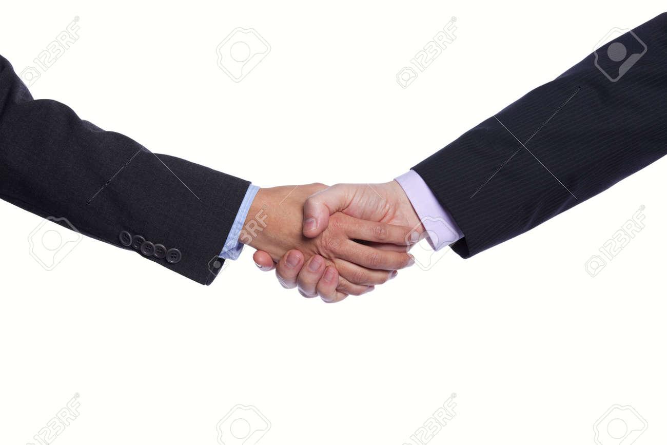 Businesspeople hands doing a handshake (selective focus) Stock Photo - 9272736