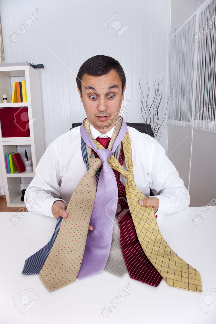 mature businessman looking to a lot of neckties, thinking what to choose Stock Photo - 9288177