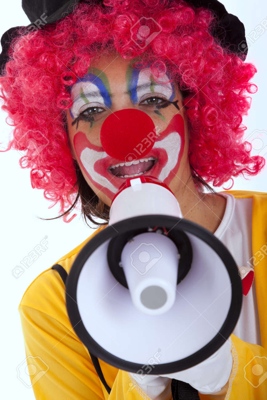 loud funny message from a clown with a megaphone (isolated on whites) Stock Photo - 9280215