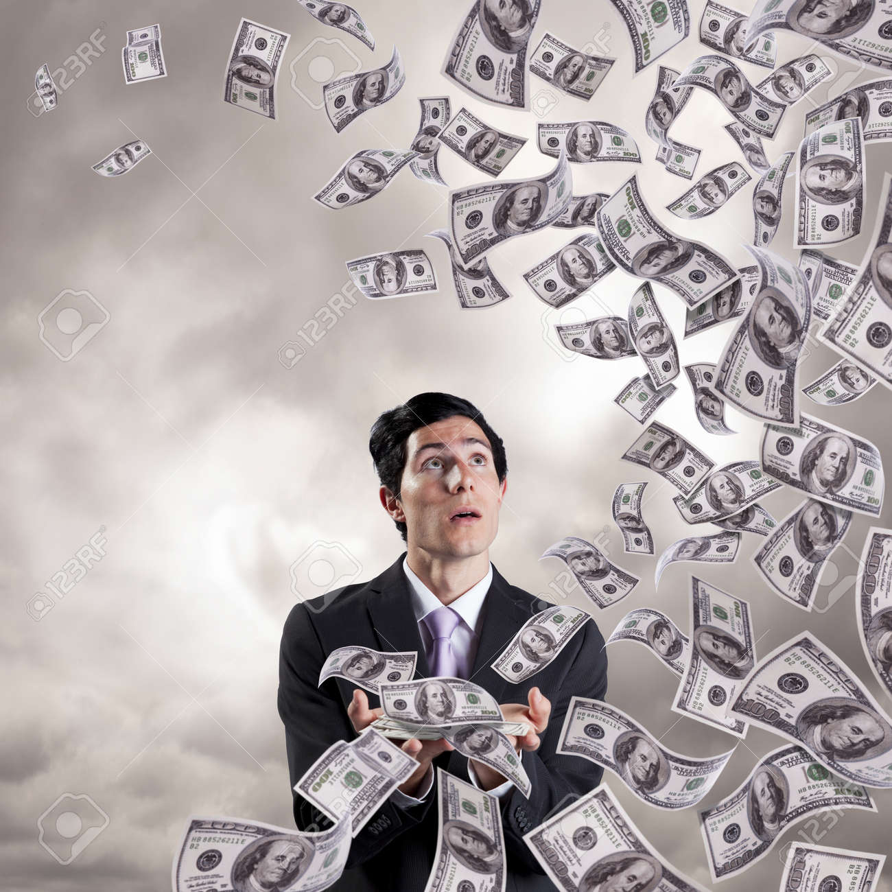 businessman loosing money from his hands (isolated on white) Stock Photo - 9280114