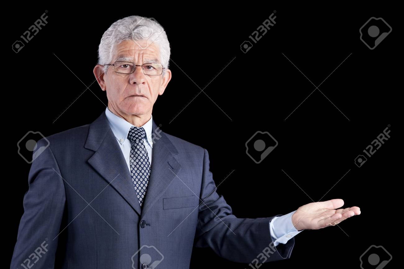 senior businessman showing something with his hands (isolated on black Stock Photo - 10030393