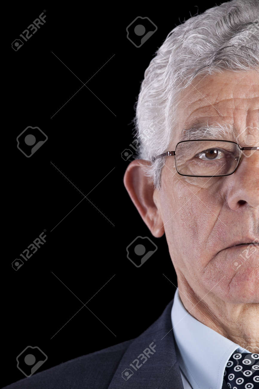 Half face from a senior Businessman isolated on back Stock Photo - 10030083