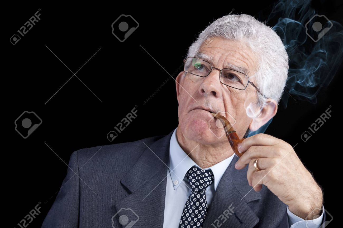 Senior businessman thinking while smoking his pipe (isolated on black) Stock Photo - 10030624