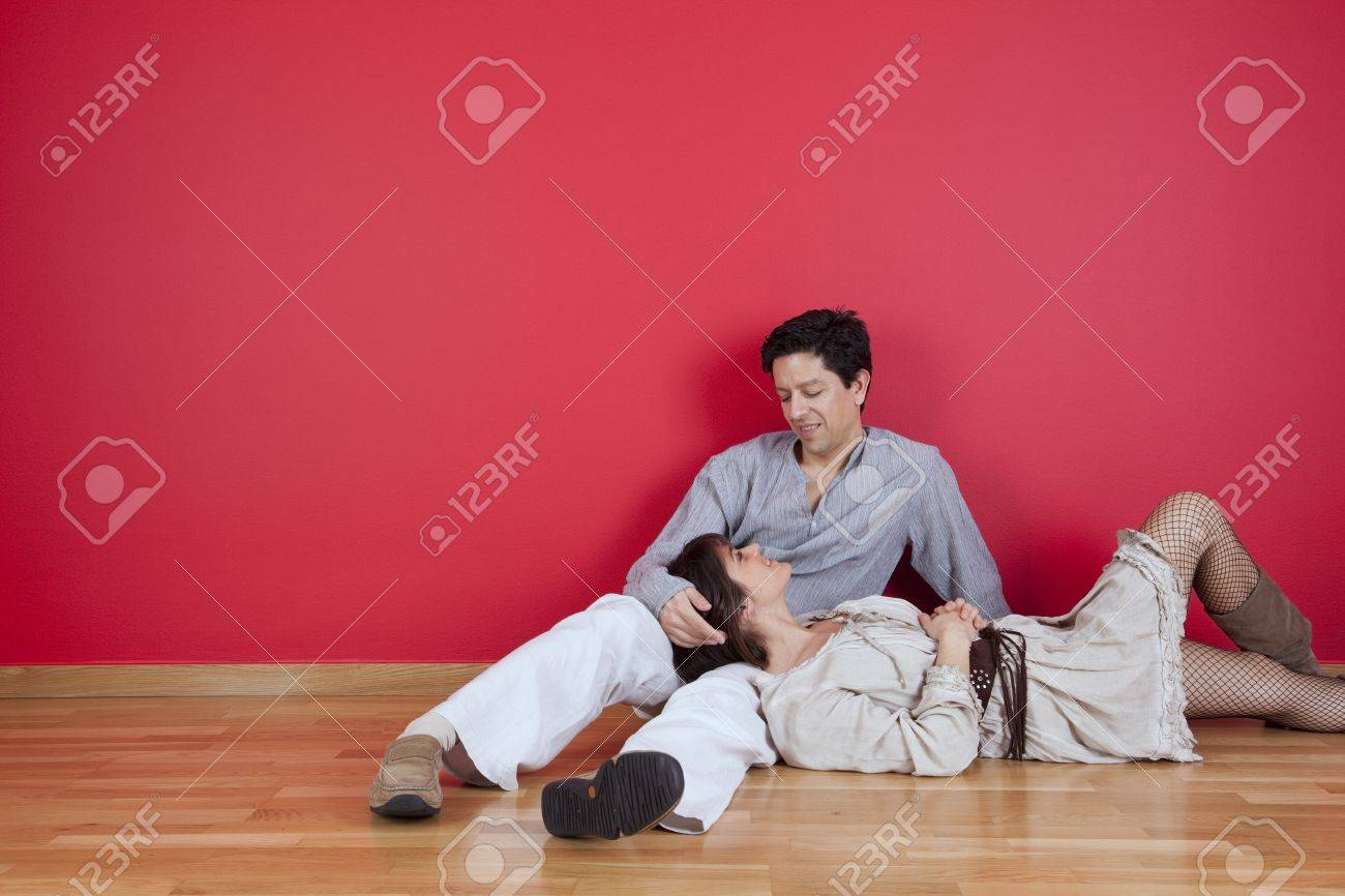 mature couple sited in the floor of his new house Stock Photo - 10035764